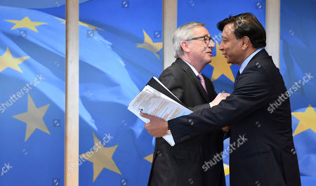 Lakshmi Mittal, right, CEO of ArcelorMittal, is greeted by European Commission President Jean-Claude Juncker prior to a meeting at EU headquarters in Brussels on