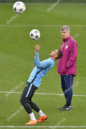 Manchester City's coach Brian Kidd (R) look-on as Danilo controls the ball during a training session at the Manchester City training ground in Manchester, Britain, 06 March 2018. Manchester City will face FC Basel FC in a UEFA Champions League round of 16 second leg soccer match on 07 March 2018.