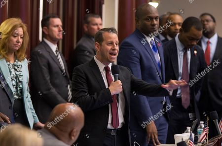 Stock Picture of As supporters stand behind him, Rep. Jared Evan Moskowitz (D-Coral Springs) closes on his amendment to the school safety bill at the Florida Capital in Tallahassee, Fla