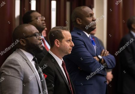 Stock Photo of Florida Rep. Jared Evan Moskowitz (D-Coral Springs), center, watches the vote on his amendment to the school safety bill as it is voted down 42-71 at the Florida Capital in Tallahassee, Fla