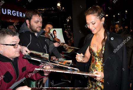 Alicia Vikander signing an autograph for fans