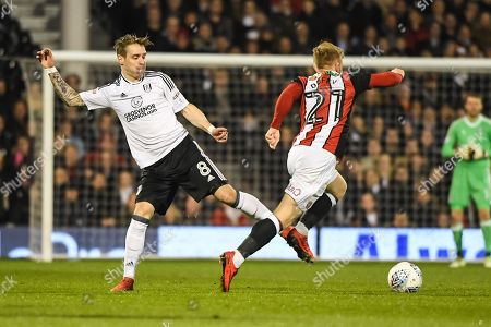 Fulham Midfielder Stefan Johansen (8) and Sheffield United Midfielder Mark Duffy (21) battle for the ball during the EFL Sky Bet Championship match between Fulham and Sheffield United at Craven Cottage, London. Picture by Stephen Wright