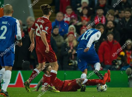 Alberto Moreno of Liverpool (C) in action with Jesus Manuel Corona of FC Porto (R) during the UEFA Champions League round of 16 second leg soccer match between Liverpool FC and FC Porto in Liverpool, Britain, 06 March 2018.