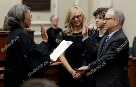 Nashville Vice Mayor David Briley, right, is sworn in to replace Mayor Megan Barry, in Nashville, Tenn. Briley was sworn in hours after Barry pleaded guilty to stealing thousands of dollars from the city while carrying on an extramarital affair with her bodyguard. Barry then resigned Tuesday