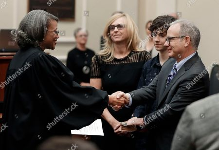 David Briley, Angelita Dalton. Nashville Vice Mayor David Briley, right, is congratulated after being sworn in by Davidson County Criminal Court Judge Angelita Dalton, left, to replace Mayor Megan Barry, in Nashville, Tenn. Briley was sworn in hours after Barry pleaded guilty to stealing thousands of dollars from the city while carrying on an extramarital affair with her bodyguard. Barry then resigned Tuesday