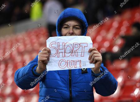 A Sunderland fan holds up a sign in protest of owner Ellis Short