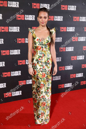 Actress Alicia Vikander poses for photographers upon arrival at the premiere of the film 'Tomb Raider', in London