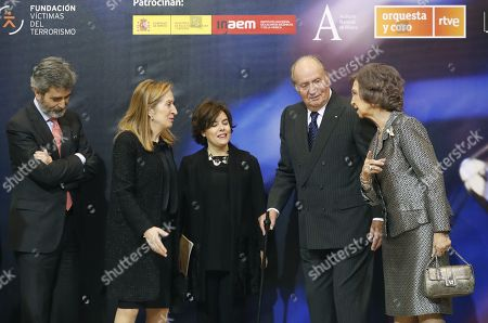 Stock Picture of Spanish emeritus King Juan Carlos I (2-R) and Queen Sofia (R) chat with Spanish Speaker of the Parliament's Lower Chamber, Ana Pastor (2-L) and Spanish Deputy Prime Minister, Soraya Saenz de Santa Maria (C), as they attend the XVI 'In Memoriam' concert as a tribute to Spanish victims of terrorist attacks at the National Auditorium in Madrid, Spain, 06 March 2018.