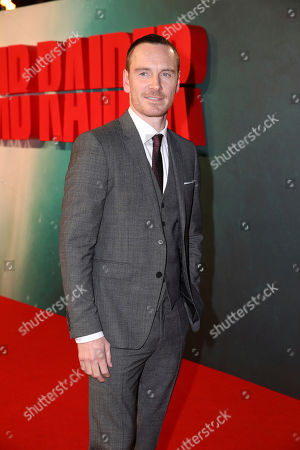 Actor MIchael Fassbender poses for photographers on arrival at the premiere of the film 'Tomb Raider', in London