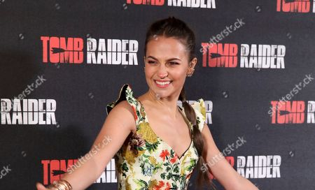 Actress Alicia Vikander poses for photographers on arrival at the premiere of the film 'Tomb Raider', in London