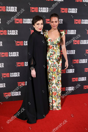 Kristin Scott Thomas, Alicia Vikander. Actresses Kristin Scott Thomas, left, and Alicia Vikander pose for photographers on arrival at the premiere of the film 'Tomb Raider', in London