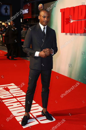 Ballet Dancer Eric Underwood poses for photographers on arrival at the premiere of the film 'Tomb Raider', in London