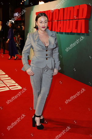Actress Jaime Winstone poses for photographers on arrival at the premiere of the film 'Tomb Raider', in London