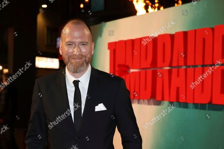 Film Director Roar Uthaug poses for photographers on arrival at the premiere of the film 'Tomb Raider', in London