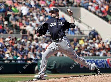 New York Yankees' Jordan Montgomery pitches against the Detroit Tigers in the first inning of a spring baseball exhibition game, in Lakeland, Fla