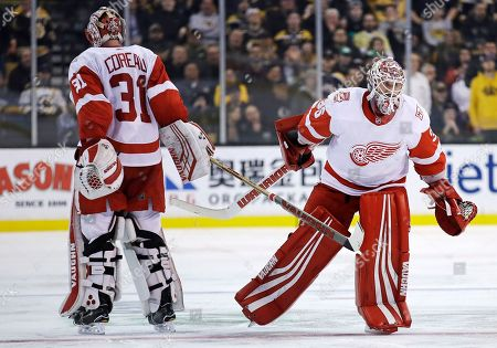 Stock Image of Jimmy Howard, Jared Coreau. Detroit Red Wings goaltender Jimmy Howard, right, replaces goaltender Jared Coreau, who had allowed a goal by Boston Bruins left wing Brad Marchand, during the second period of an NHL hockey game in Boston