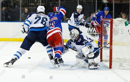 Blake Wheeler, David Deharnais, Steve Mason. Winnipeg Jets right wing Blake Wheeler (26) and Jets goaltender Steve Mason (35) keep New York Rangers center David Desharnais (51) from getting to the puck in front of the Jets crease during the second period of an NHL hockey game in New York