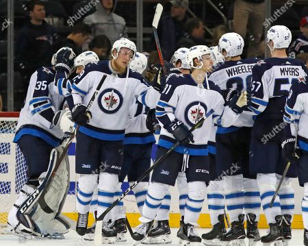 Stock Picture of Patrik Laine, Steve Mason. Winnipeg Jets right wing Patrik Laine (29) of Finland, thrid from left, celebrates with teammates after the Jets shut out the New York Rangers 3-0 in an NHL hockey game in New York, . Laine had all three goals for the Jets for a hat trick. Winnipeg Jets goaltender Steve Mason (35), starting for the first time in 21 games after suffering a concussion, is at far left