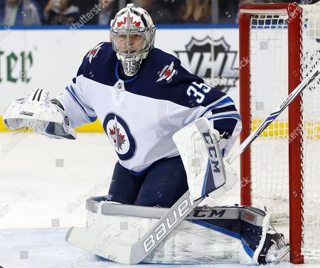 Winnipeg Jets goaltender Steve Mason (35) works in the net during the second period of an NHL hockey game against the New York Rangers in New York, . Mason was back starting at his position for the first time since Jan. 9 after suffering a concussion