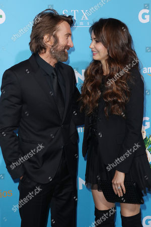 Stock Picture of Sharlto Copley and Tanit Phoenix