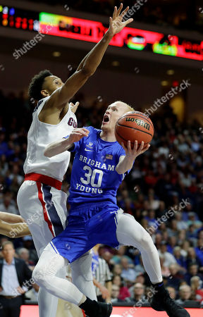 Gonzaga's Johnathan Williams covers a shot from BYU's TJ Haws during the first half of the West Coast Conference tournament championship NCAA college basketball game, in Las Vegas