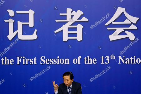 China's Finance Minister Xiao Jie speaks during a press conference on the sidelines of the National People's Congress at the media center in Beijing, . Xiao tried Wednesday to defuse concern over the country's rising debt, saying government borrowing is below danger levels and regulators can prevent financial system risks