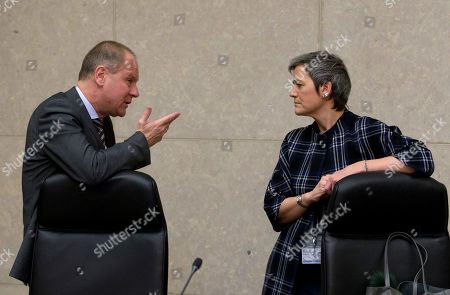 European Commissioner for Education Tibor Navracsics, left, speaks with European Commissioner for Competition Margrethe Vestager during a meeting of the College of the European Commission at EU headquarters in Brussels on . The European Union will set out its strategy Wednesday on how to counter potential U.S. punitive tariffs on steel and aluminum