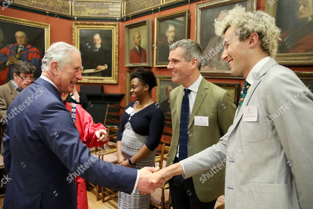 Prince Charles (L) talks to Architectural Designer Ben Pentreath (2ndR) and Charlie McCormormick (R) visits the Art Worker's Guild