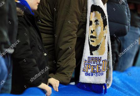 A Leeds United fan wearing a Gary Speed scarf