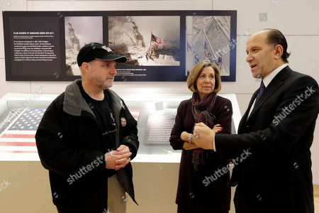 Stock Picture of Alex Kaminsky, Howard Lutnick, Aliced Greenwald. Alex Kaminsky, left, Wind Symphony director from Marjory Stoneman Douglas High School, in Parkland, Fla., talks with 9/11 Memorial Museum Director Alice Greenwald and Cantor Fitzgerald CEO Howard Lutnick during the school symphony's visit to the 9/11 Museum & Memorial, in New York, . The group, who had planned the trip before the Feb. 14 shooting rampage at their school, toured the museum that commemorates the deadliest act of terrorism on U.S. soil