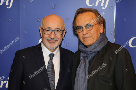 CRIF president Francis Kalifat, left, poses with French director Alexandre Arcady during the 33rd annual dinner of the group CRIF, Representative Council of Jewish Institutions of France, in Paris