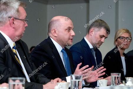 Estonian Defense Minister Juri Luik, center, speaks during a meeting with Defense Secretary Jim Mattis at the Pentagon in Washington