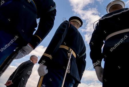 Defense Secretary Jim Mattis, bottom left, arrives for an enhanced honor cordon for Estonian Defense Minister Juri Luik at the Pentagon in Washington