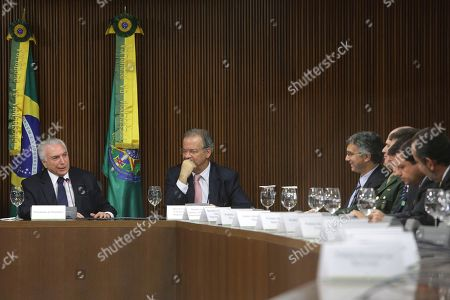 Michel Temer, Raul Jungmann. Brazil's President Michel Temer, left, sits next to Security Minister Raul Jungmann, second left, as he speaks during a meeting with mayors about the national security plan, at the Planalto Presidential Palace, in Brasilia, Brazil, . According to the presidency, the proposals presented by the federal government to fight violence and support the security plans of the prefectures of the Brazilian states were presented to the mayors