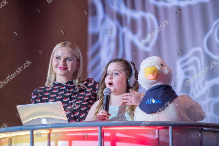 Stock Photo of Year old cancer survivor and Children's Miracle Network champion Chloe Davison from Grants Pass, Oregon, joins singer, fashion columnist and actress Alli Simpson reporting on social media activities during the Children's Hospital Week Facebook live event on in Orlando, Fla. Aflac is a sponsor of Children's Hospital Week