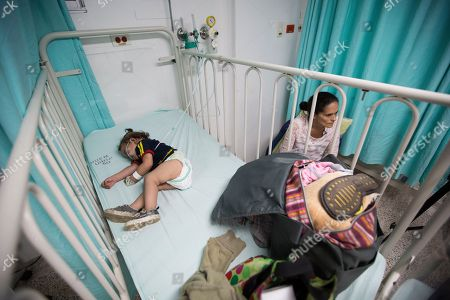Venezuelan Jessica Sanchez sits next to her daughter Mavis Urriola at a hospital in Cucuta, Colombia. Mavis suffers from a heart ailment. Venezuelans are facing mounting health challenges. Cases of infant and maternal mortality have risen sharply, and long-eradicated maladies like diphtheria have reemerged
