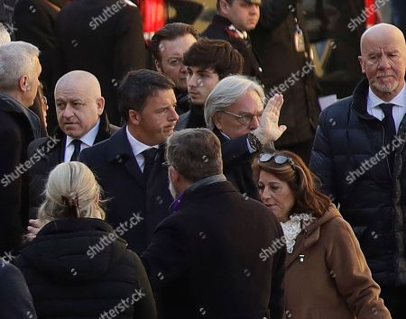 Former premier and Democratic Party president Matteo Renzi, center, arrives with Fiorentina owner Diego Della Valle, for the funeral ceremony of Italian player Davide Astori in Florence, Italy, . The 31-year-old Astori was found dead in his hotel room on Sunday after a suspected cardiac arrest before his team was set to play an Italian league match at Udinese