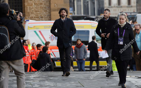 Italian soccer players association president Damiano Tommasi arrives for the funeral ceremony of Italian player Davide Astori in Florence, Italy, . The 31-year-old Astori was found dead in his hotel room on Sunday after a suspected cardiac arrest before his team was set to play an Italian league match at Udinese