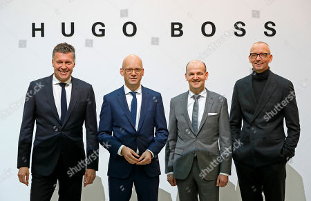 (L-R) Bernd Hake, Chief Sales Officer (CSO), Mark Langer, Chief Executive Officer (CEO) of HUGO BOSS, Yves Mueller, Chief financial officer, Ingo Wilts, PR Fashion, Global Advertising, stand in front of a wall with a Logo before the annual press conference in Metzingen, Germany, 08 March 2018. The Hugo Boss AG is a German fashion company based in Metzingen in Baden-Wuerttemberg. The company reported that sales decreased by two per cent in the 2017 financial year.