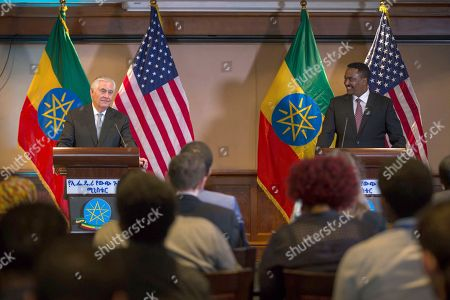 US Secretary of State Rex Tillerson, left, addresses the media after his meeting with Ethiopian Foreign Minister Dr. Workneh Gebeyehu at a joint press conference in Addis Ababa, Ethiopia, . The top U.S. diplomat and a top African official tried Thursday to move past President Donald Trump's slur about Africa, deeming it a closed matter that need not be revisited