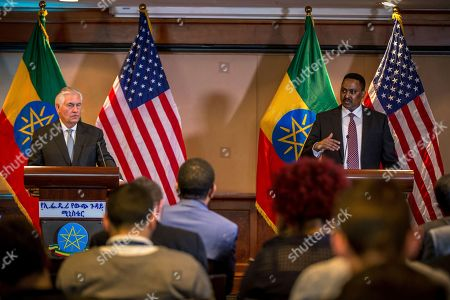 US Secretary of State Rex Tillerson, left, watches as Ethiopian Foreign Minister Dr. Workneh Gebeyehu, addresses the media after their meeting at a joint press conference, in Addis Ababa, Ethiopia, . The top U.S. diplomat and a top African official tried Thursday to move past President Donald Trump's slur about Africa, deeming it a closed matter that need not be revisited