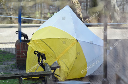 A gust of wind exposes the bench from under the forensic screen tent, in the Cathedral City of Salisbury, Wiltshire, southern England, 08 March 2018, on which ex Russian spy Sergei Skripal aged 66 and his daughter Yulia aged 33 were found suffering from extreme exposure to a rare nerve agent on 04 March 2018. The London Metropolitan Police Service (MPS) reported on 07 March 2018 that Detectives investigating how former Russian spy Sergei and Yulia Skripal became seriously ill in Salisbury southern England on 04 March 2018 continue to work with specialist health experts. Police are now in a position to confirm that their symptoms are a result of exposure to a nerve agent. Scientific tests by Government experts have identified the specific nerve agent used which will help identify the source but at this stage in a fast-paced ongoing investigation we will not comment further. Assistant Commissioner Mark Rowley, the head of Counter Terrorism Policing, said: 'Having established that they were exposed to a nerve agent we are now treating this as a major incident involving an attempted murder by the administration of a nerve agent.'