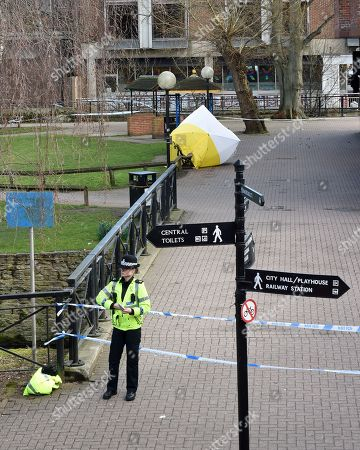 Police guard the bench covered by a forensic screen tent, in the Cathedral City of Salisbury, Wiltshire, southern England, 08 March 2018, on which ex Russian spy Sergei Skripal aged 66 and his daughter Yulia aged 33 were found suffering from extreme exposure to a rare nerve agent on 04 March 2018. The London Metropolitan Police Service (MPS) reported on 07 March 2018 that Detectives investigating how former Russian spy Sergei and Yulia Skripal became seriously ill in Salisbury southern England on 04 March 2018 continue to work with specialist health experts. Police are now in a position to confirm that their symptoms are a result of exposure to a nerve agent. Scientific tests by Government experts have identified the specific nerve agent used which will help identify the source but at this stage in a fast-paced ongoing investigation we will not comment further. Assistant Commissioner Mark Rowley, the head of Counter Terrorism Policing, said: 'Having established that they were exposed to a nerve agent we are now treating this as a major incident involving an attempted murder by the administration of a nerve agent.'