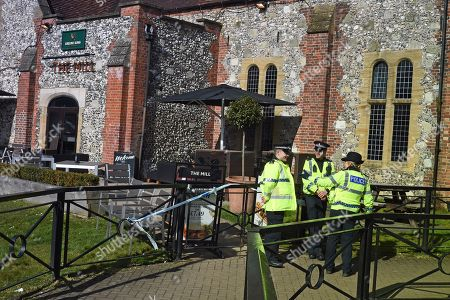 Police on duty outsideThe Mill public house in the Cathedral City of Salisbury, Wiltshire, southern England, 08 March 2018, where ex Russian spy Sergei Skripal aged 66 and his daughter Yulia aged 33 had a drink before they were found on a bench suffering from extreme exposure to a rare nerve agent on 04 March 2018. The London Metropolitan Police Service (MPS) reported on 07 March 2018 that Detectives investigating how former Russian spy Sergei and Yulia Skripal became seriously ill in Salisbury southern England on 04 March 2018 continue to work with specialist health experts. Police are now in a position to confirm that their symptoms are a result of exposure to a nerve agent. Scientific tests by Government experts have identified the specific nerve agent used which will help identify the source but at this stage in a fast-paced ongoing investigation we will not comment further. Assistant Commissioner Mark Rowley, the head of Counter Terrorism Policing, said: 'Having established that they were exposed to a nerve agent we are now treating this as a major incident involving an attempted murder by the administration of a nerve agent.'