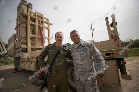 Stock Image of US Air Force  Lt. Gen. Richard Clark, United States European Command (R) and Israeli Brig. Gen. Zvika Haimovich (L) standing next to a Patriot missile Defense system at the Israeli Air Force Base of Hatzor, in central Israel, 08 March 2018 during a joint IDF-US military exercise 'Juniper Cobra  2018'. The ninth 'Juniper Cobra' exercise runs from 04 - 15 March 2018. Over 2,500 US troops deployed in Europe will be participating in the exercise, alongside 2,000 Israeli Aerial Defense troops. The exercise simulates a scenario in which US forces would deploy to Israel in order to aid the IDF Aerial Defense forces, The simulations will include the use of the 'Arrow,' 'Iron Dome', 'Patriot', and 'David's Sling' Systems, that were declared operational in April 2017.