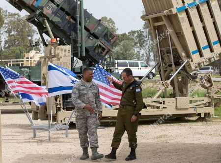 US Air Force  Lt. Gen. Richard Clark (L), United States European Command and Israeli Brig. Gen. Zvika Haimovich (R) standing next to a Patriot missile Defense system at the Israeli Air Force Base of Hatzor, in central Israel, 08 March 2018 during a joint IDF-US military exercise 'Juniper Cobra  2018'. The ninth 'Juniper Cobra' exercise runs from 04 - 15 March 2018. Over 2,500 US troops deployed in Europe will be participating in the exercise, alongside 2,000 Israeli Aerial Defense troops. The exercise simulates a scenario in which US forces would deploy to Israel in order to aid the IDF Aerial Defense forces, The simulations will include the use of the 'Arrow,' 'Iron Dome', 'Patriot', and 'David's Sling' Systems, that were declared operational in April 2017.