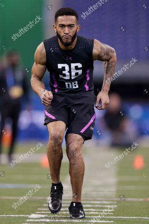 Oklahoma defensive back J T Thomas runs a drill at the NFL football scouting combine in Indianapolis
