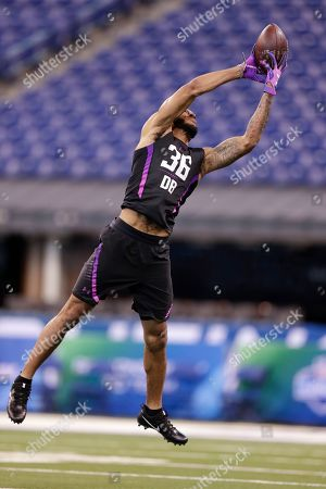 Stock Image of Oklahoma defensive back J T Thomas runs a drill at the NFL football scouting combine in Indianapolis