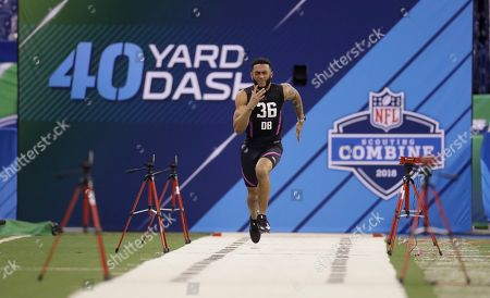 Stock Photo of Oklahoma defensive back J T Thomas runs the 40-yard dash during the NFL football scouting combine, in Indianapolis