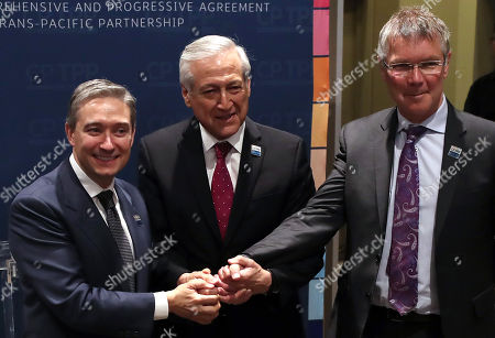 Minister of Foreign Affairs of Chile Heraldo Munoz (C), Canadian Trade Minister François-Philippe Champagne (L) and New Zealand Trade Minister David Parker (R) make a joint statement before signing the Trans-Pacific Partnership in Santiago, Chile, 08 March 2018. The TPP comprises Australia, Brunei, Canada, Chile, Malaysia, Mexico, Japan, New Zealand, Peru, Singapore and Vietnam. Unlike the original agreement signed two years ago, the deal does not include the United States as the administration led by President Donald Trump decided to pull out of it.